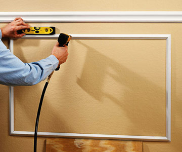 attach frame to wall with nailer