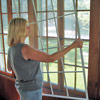 Install interior storm window