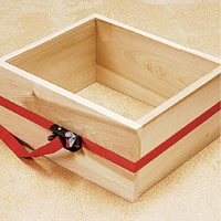 Band clamp holding box together
