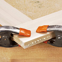 Spring clamps holding glued boards