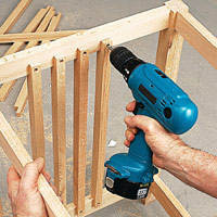 Attach spindles to side rails