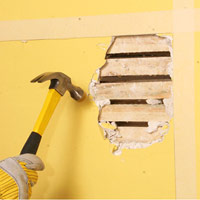 Break plaster away from lath