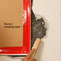 Remove loose stucco with wire brush