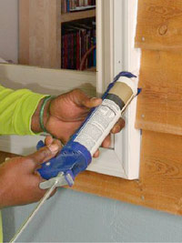 Caulk with caulking gun