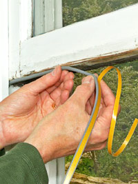 Apply weatherstripping to sash