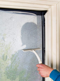 Wipe film with squeegee