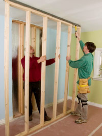 Raise wall into position with helper