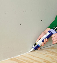 Caulk with acoustical sealant