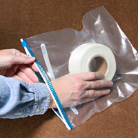 Place tape in bag