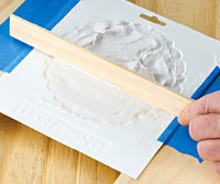 Fill mold with plaster