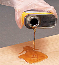 Pour oil onto wood