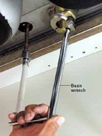 Loosen nut with basin wrench