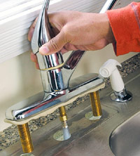 Slip new faucet into place