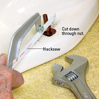 Cut through bolt with hacksaw