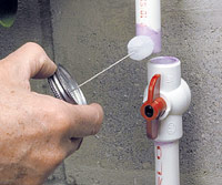 Apply primer to pipe and valve