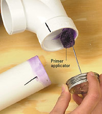 Apply primer to inside of fitting