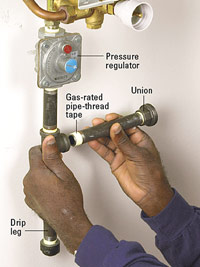 Attach pipes to pressure regulator