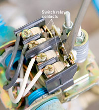 Pry back switch relay contacts