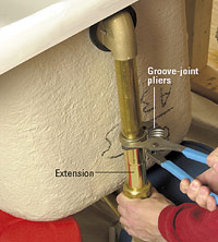Tighten nut on drain extension