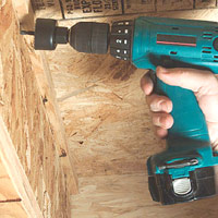 Drill holes in joists