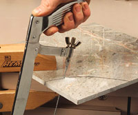 Cutting tile with hacksaw