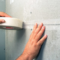 Press fiberglass tape into joint