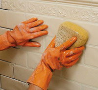 Clean surface with damp sponge