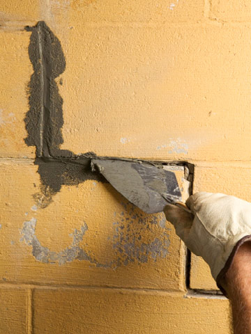 Force Hydraulic Cement Into Crack Enlarge Image. Painting A Masonry Wall:  ...