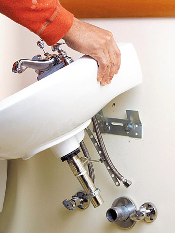 ... the drain body on the sink lower the sink onto the bracket slide the