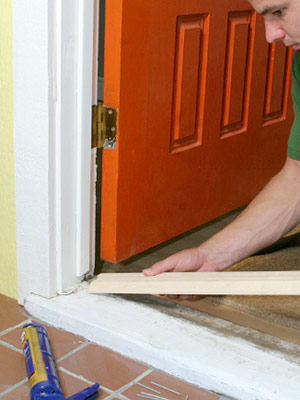 Replacing a sill and threshold how to repair any door in your house diy advice for How to install a threshold for an exterior door