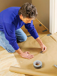 Tape paper to subfloor