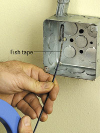 Push fish tape into conduit