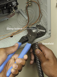 Clamp conduit to panel