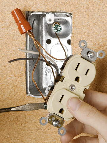 replacing a receptacle how to install a switch or receptacle attach ground wire enlarge image
