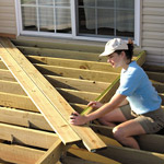 woman measuring deck dimensions