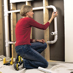 woman marking pipes