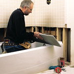 man finishing bathtub