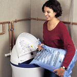 woman pouring water softener salt