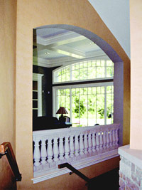 Arched opening mirrors bow-top window