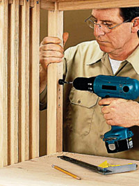Drill shelf peg holes