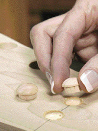 Glue screw-hole buttons into holes