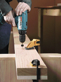 Predrill holes through rail