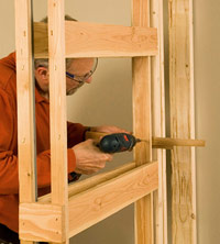 Attach door frame to stud