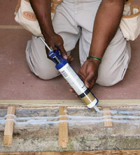 Apply caulk at sill plate
