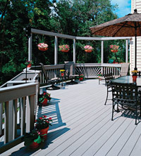 Synthetic deck with railing