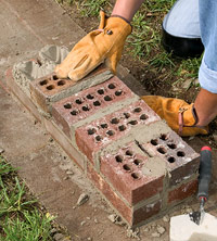 Mortar bricks together
