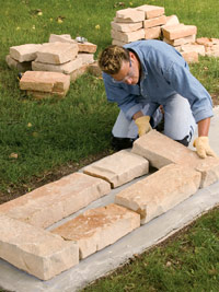 Lay stone on footings