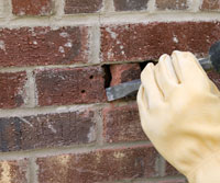 Remove damaged brick
