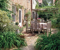 Narrow patio with table and chairs