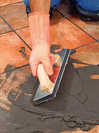 Put grout over tile